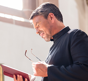 Priest reading Bible for web.jpg
